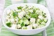 salad with cucumber, tofu, green onions and sesame seeds closeup