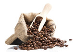 Fototapety coffee beans in bag with wooden spoon.