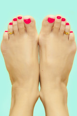 Feet with painted red nails