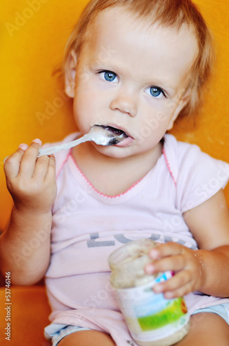 baby girl eating puree