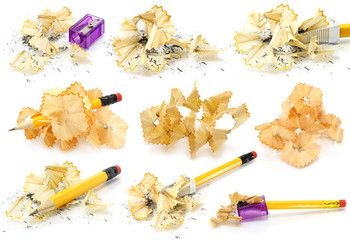 Pencils and wood shavings set on a white background .
