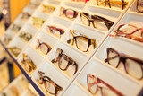 Eyeglasses, shades and sunglasses in optometrist's shop
