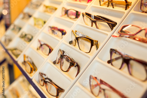 Eyeglasses, shades and sunglasses in optometrist's shop - 53750140