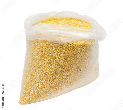 millet in a plastic bag on a white background