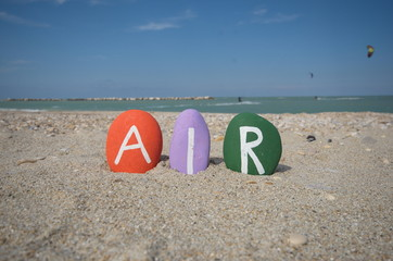 Air concept with three colourful stone letters