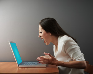 angry woman with laptop