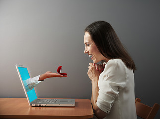 woman looking at ring