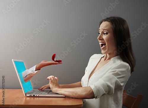 woman looking at wedding ring