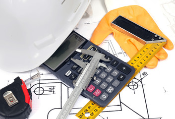 helmet, calculator, rule on a technical drawing