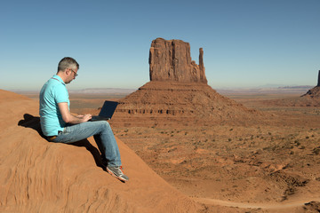 Business man in the Monument Valley