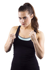 young woman in fighting stance on white background