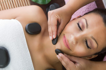 Beauty woman relaxing in spa. Stone massage.