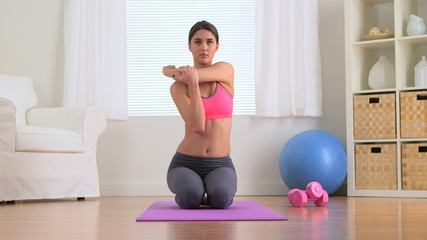 Healthy woman stretching before workout