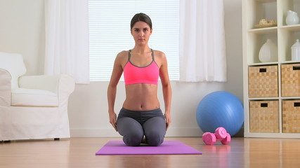 Healthy woman posing in work out clothes