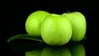 Green apples with water drops