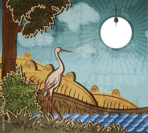 Stork in front of countryside.