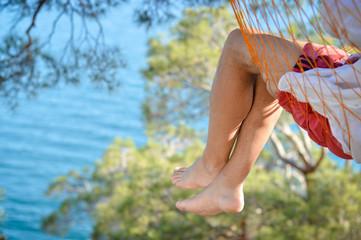 Man relaxing in a hammock on a beautiful Crimean seacoast