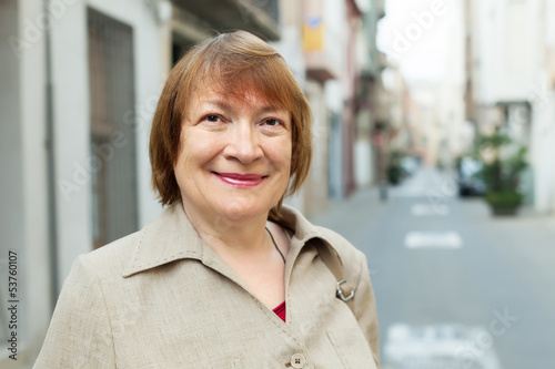 Outdoor portrait of european mature woman