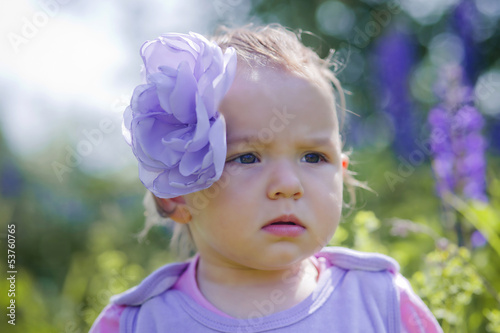 Portrait of little girl in a field of flowers