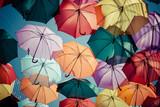 Fototapety Background colorful umbrella street decoration.