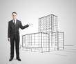 businessman showing skyscraper