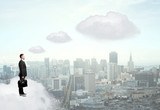 businessman standing on cloud