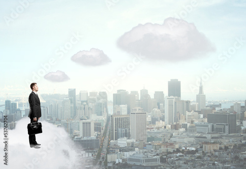 businessman standing on cloud
