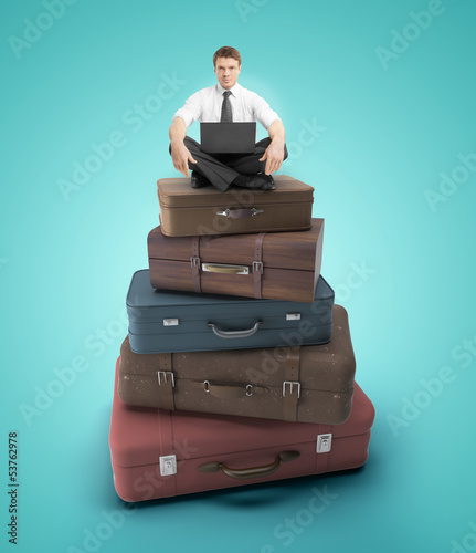 man sitting on bags