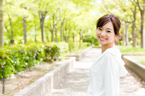 young asian woman in the park