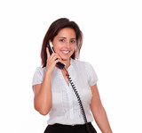 Smiling hispanic woman talking on phone