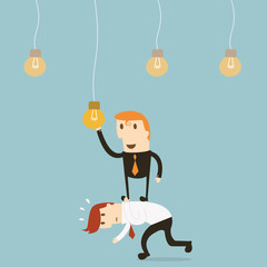 Businessman catching a light bulb