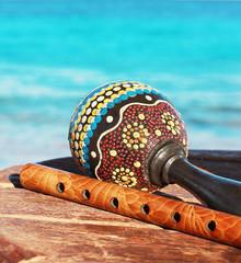 Maracas and fife with a sea background