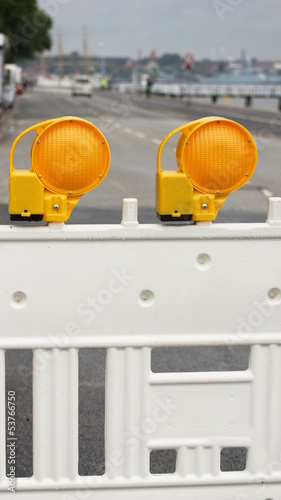 road barrier - two yellow warning lights