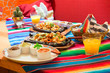 Mexican chicken fajitas with sauces on the table