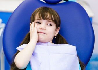 little girl at the dentist complains of toothache.