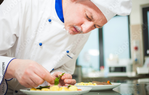 Chef garnishing a dish