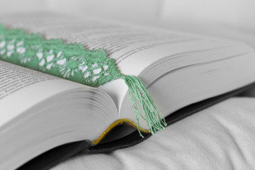 Open book with green bookmark