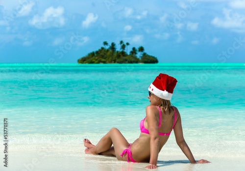 santa claus woman on beach