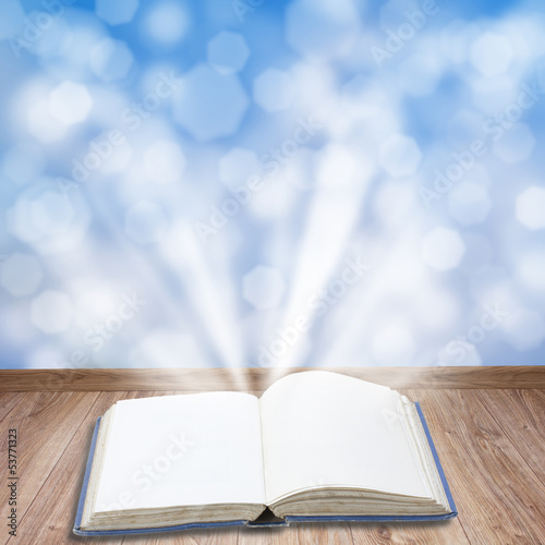 book with magic light
