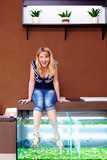 young girl taking fish pedicure spa treatment