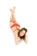Woman in bikini laying on the floor