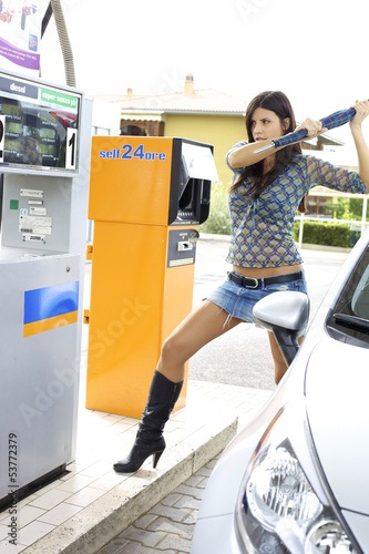Woman ready to destroy gas station