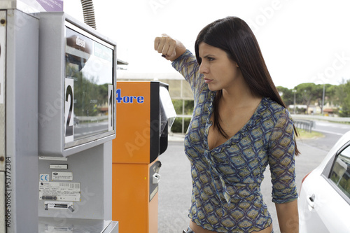Woman willing to punch gas station