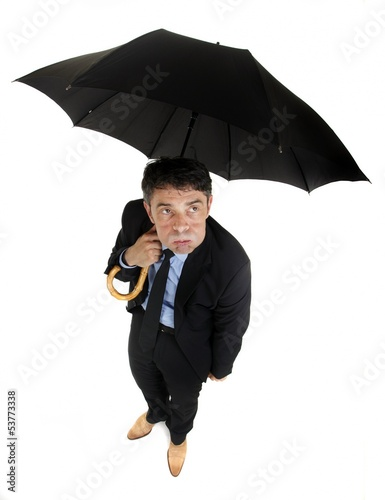 Morose businessman eyeing the weather