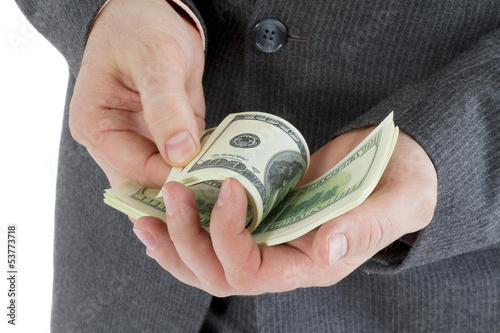 stack banknotes of 100 dollars in male hands