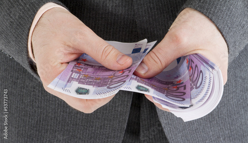stack banknotes of 500 euro in male hands