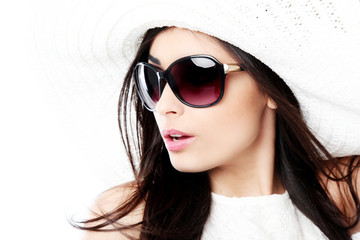 Beautiful girl with hat and sunglasses