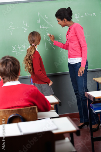 Female Teacher Teaching Mathematics To Students
