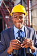 african american petrochemical manager with binoculars