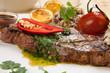 Piece of Medium Rare Steak with Spicy Herb Sauce
